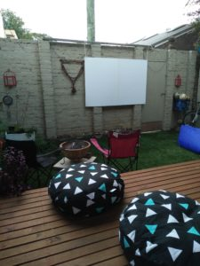 Make your own collapsible screen for outdoor movie nights.